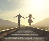 The young couple walking on a railway track.  This is a 3d render illustration