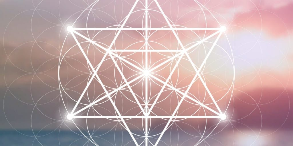 Merkaba sacred geometry spiritual new age futuristic illustration with interlocking circles, triangles and glowing particles in front of colorful blurry natural photographic background