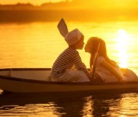 children_friends_kiss_in_boat-wide